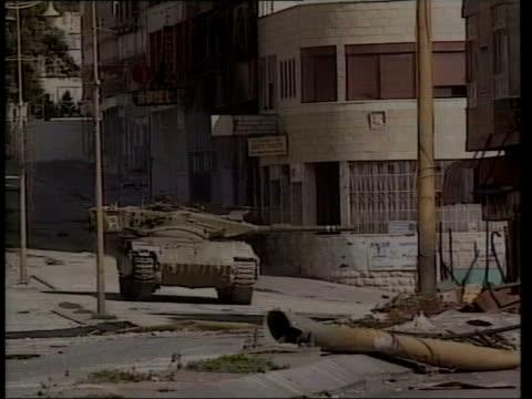 stockvideo's en b-roll-footage met blair returns from middle east lib israel west bank israeli tank in palestinian area rotating turret palestinian gunmen firing machine guns israeli... - israëlisch palestijns conflict