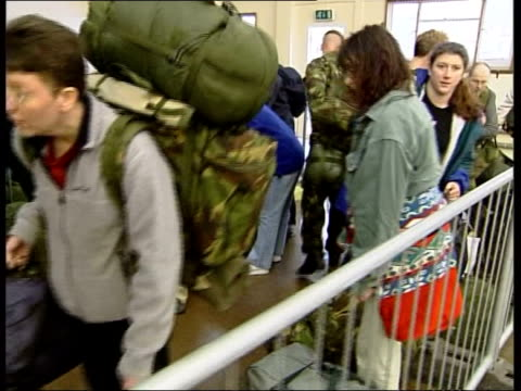 British reservists ITN ENGLAND Nottingham Army reservists from coach and collecting kit bags CMS Male and female reservists along carrying kit TRACK...