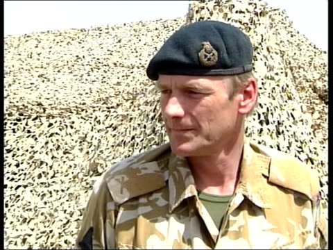 british / us forces; lunchtime news: tim ewart itn kuwait: ext sea king helicipter in flight over british military camp in desert lms side major... - pull ups stock videos & royalty-free footage