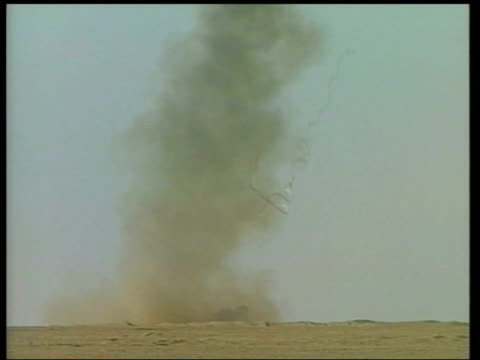 british / us forces; news at ten: james mates itn kuwait ext lbv us marine armoured vehicle as large explosion used to clear minefields seen behind... - amphibious vehicle stock videos & royalty-free footage