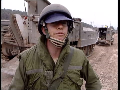 military action continues/bush-blair summit; itn israel: jenin: int vehicle palestinian men sitting by road bound and blindfolded by the israeli army... - military land vehicle stock videos & royalty-free footage