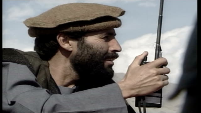 Latest events ITN Northern Alliance soldiers receiving walkie talkie messages from Taliban troops Northern Alliance tank firing ITN Smoke rising in...