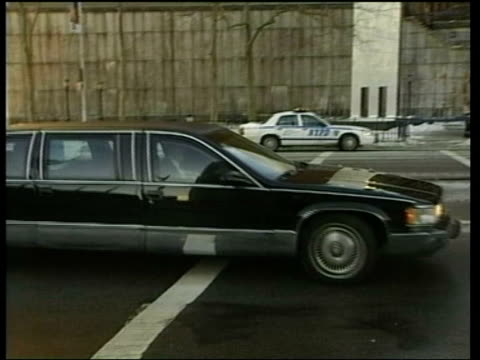 New deadline/Blix report ITN USA New York Limousine carrying US Secretary of State Colin Powell along PAN ZOOM IN Powell seen in back of car