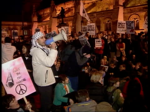 parliamentary debate; itn england: london: westminster: ext/night gv anti-war protesters demonstrating outside parliament protesters chanting sot - protestor stock videos & royalty-free footage
