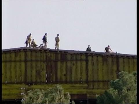 us troops deployed/ allied casualties lib afghanistan bagram members of the british royal marines special boat service seen on roof of hangar at... - bagram stock videos & royalty-free footage