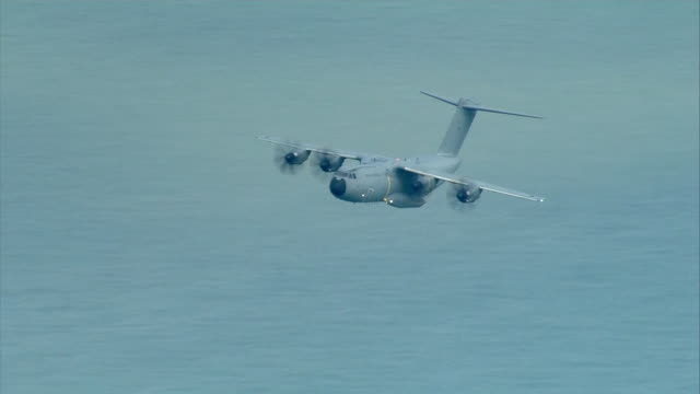 military aeroplane surveillance flight, airbus a400m atlas aircraft, flys over english channel and white cliffs of dover as there as been an increase... - hill stock videos & royalty-free footage