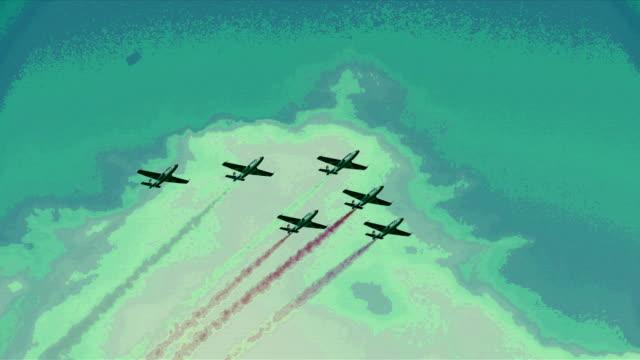 Avion militaire en formation. Fumée multicolore