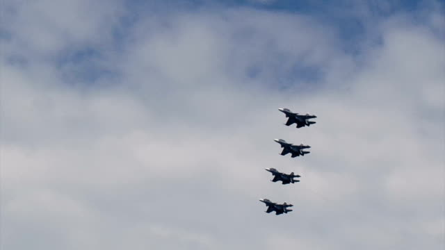 military aircraft in the cloudy sky - weaponry stock videos & royalty-free footage
