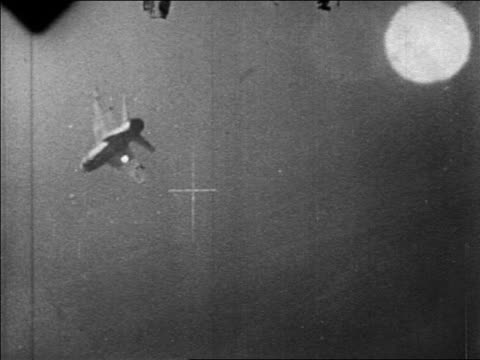 b/w 1967 military aircraft point of view thru crosshairs of mig exploding in six day war / newsreel - sechstagekrieg stock-videos und b-roll-filmmaterial