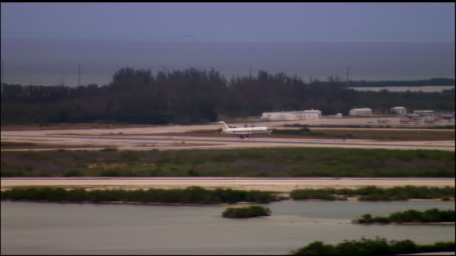 ws, ts, military airplane landing, naval air station key west, florida, usa - フロリダ州点の映像素材/bロール