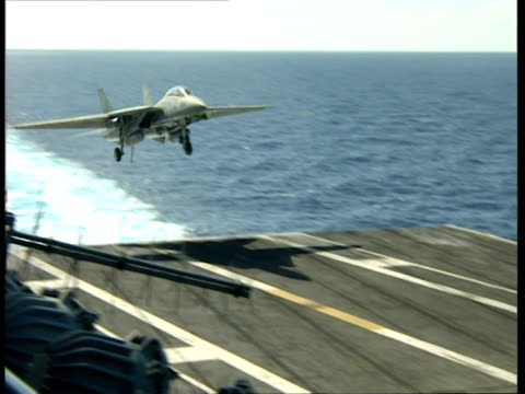 ms, ts, military airplane landing on deck of aircraft carrier - flugzeugträger stock-videos und b-roll-filmmaterial