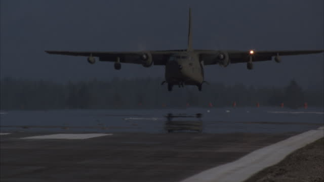 ms, pan, military airplane landing on runway - united states airforce stock-videos und b-roll-filmmaterial