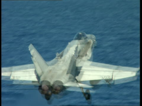 CU, TS, MS, Military airplane taking off from deck of aircraft carrier