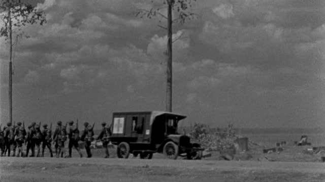 u.s. military ambulances, trucks and troops move along a dusty road. - 1927 stock videos & royalty-free footage