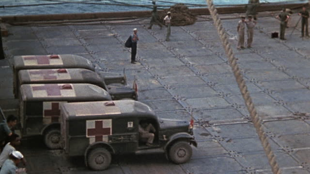 ha military ambulances with red crosses painted backing into position and parking in row of ambulances on dock during world war ii - red cross stock videos & royalty-free footage