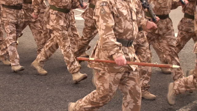 Military Army soldiers marching on the road - Homecoming Parade