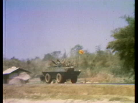 military atv races through the destroyed south vietnam countryside. - (war or terrorism or election or government or illness or news event or speech or politics or politician or conflict or military or extreme weather or business or economy) and not usa stock videos & royalty-free footage