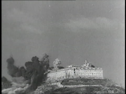military b-52s drop bombs during the battle of monte cassino, destroying a monastery. - bombardamento video stock e b–roll