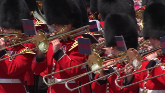 military band goes past the camera as part of the 2018 trooping the colour, where regiments of the british and commonwealth armies parade in front of... - (war or terrorism or election or government or illness or news event or speech or politics or politician or conflict or military or extreme weather or business or economy) and not usa stock videos & royalty-free footage