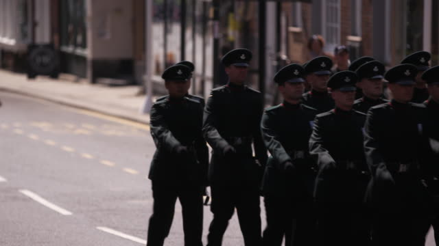 military band marches down high street in windsor, england. - (war or terrorism or election or government or illness or news event or speech or politics or politician or conflict or military or extreme weather or business or economy) and not usa stock videos & royalty-free footage