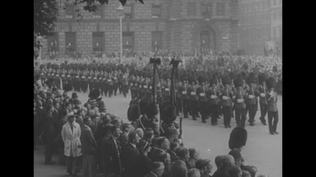 ls military band marches in funeral cortege of british field marshal viscount herbert plumer as crowd looks on from sidewalks / ls soldiers march in... - field marshal stock videos and b-roll footage