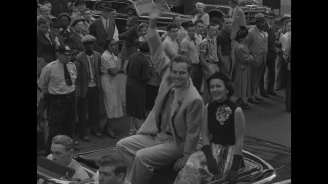 ws military band marching in parade / ms charlton heston and lydia clarke ride in convertible waving to crowd / ws rosemary clooney waves from... - lydia clarke stock videos & royalty-free footage
