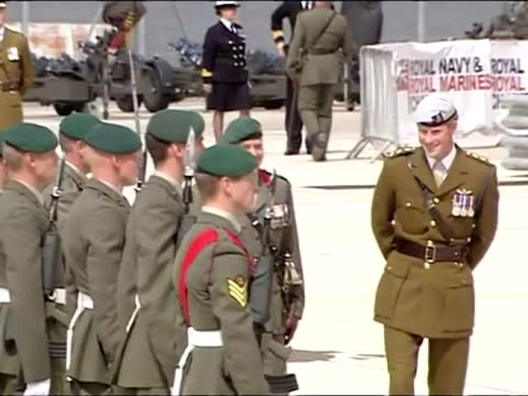 Military band music may require additional clearance** CLEAN External shots of Prince Harry inspecting and speaking to troops from 1 Assault Squadron...