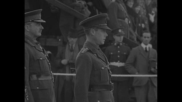 [vo military band music throughout ] military officials confer with edward prince of wales at ceremony at which he presents new colors to the 1st... - british military stock videos and b-roll footage