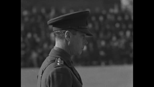 [vo military band music throughout] side view edward prince of wales stands at ceremony at which he has presented new colors to the 1st battalion of... - プリンス点の映像素材/bロール