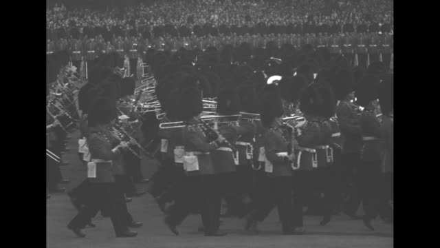 Military band of the 1st Battalion Welsh Guards marches and plays as part of the KingÕs birthday celebration Trooping the Colour flag bearer receives...