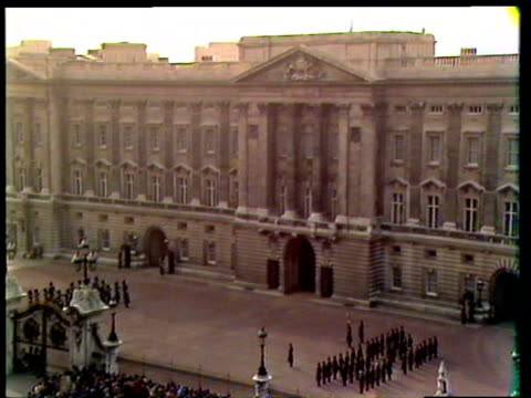 military band performing outside buckingham palace after prince charles of wales and diana spencer announced engagement / crowds waiting near palace... - princess stock videos & royalty-free footage