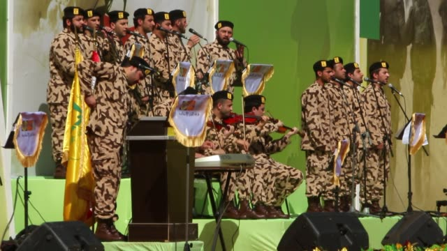 military band performs before crowd at rally in bakaa valley lebanon - hezbollah stock videos & royalty-free footage