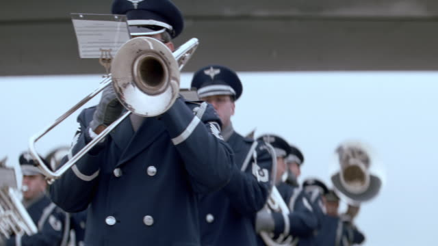 a military band plays at a military funeral ceremony. - coffin stock videos & royalty-free footage