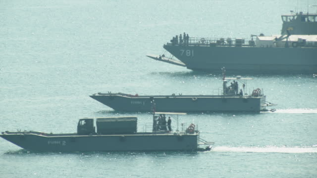 military boats approach the secured the beach head during the ongoing usthai joint military exercise titled cobra gold on hat yao beach in chonburi... - militärmanöver stock-videos und b-roll-filmmaterial