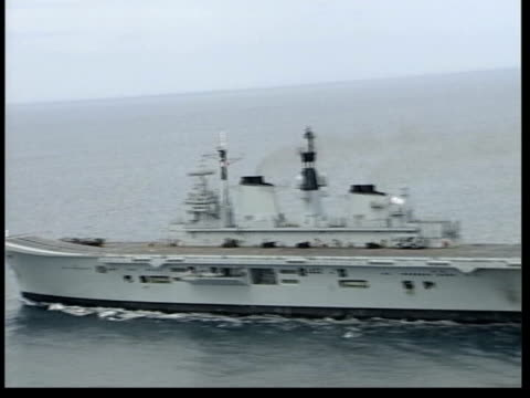 military build up/ saddam spying allegations lib aircraft carrier hms ark royal along track air view deck of the carrier - ark stock videos and b-roll footage
