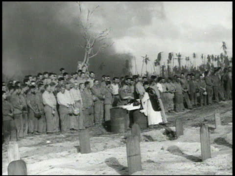 military burial cemetery on beach of roinamur us marines paying respect during burial service w/ priest on beach soldiers firing rifle salute us flag... - religious service stock videos and b-roll footage