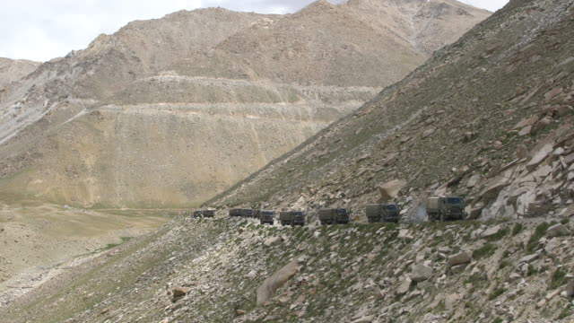 Military convoy approaching the Chang La Pass in Himalayas, Ladakh, India