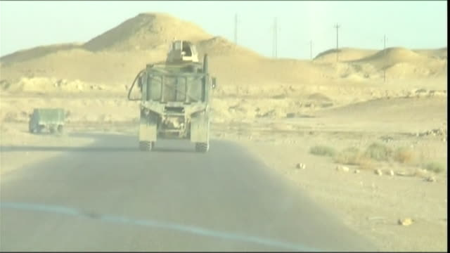 WS POV Military convoy driving towards Haditha dam, Haditha, Al Anbar, Iraq