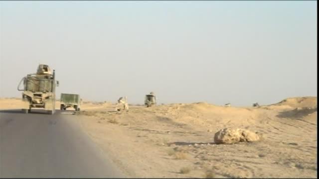 ws pov military convoy driving towards haditha dam, haditha, al anbar, iraq - convoy stock videos and b-roll footage