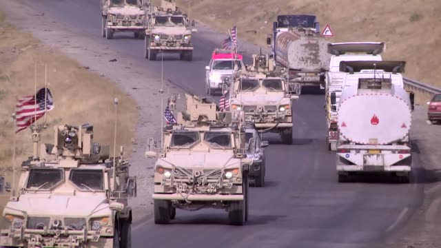 a military convoy of us forces makes its way through erbil iraq on october 21 2019 the us has started withdrawal from military bases in the... - iraq stock videos & royalty-free footage