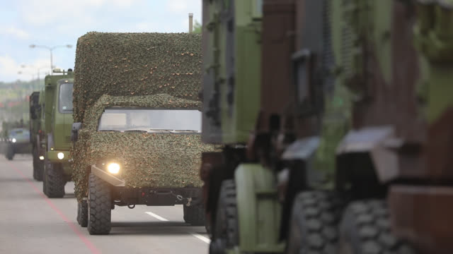 military convoy passing through the town - military training stock videos & royalty-free footage