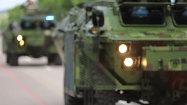 military convoy passing through the town - army exercise stock videos and b-roll footage