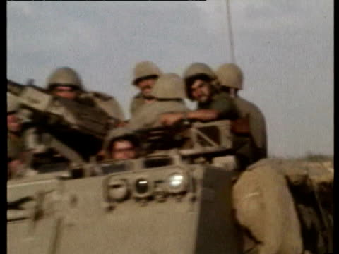 vídeos de stock, filmes e b-roll de military convoys on their way to sinai desert / israeli m113 amoured personnel carriers moving along road, tank transporter vehicle and trucks in... - 1973