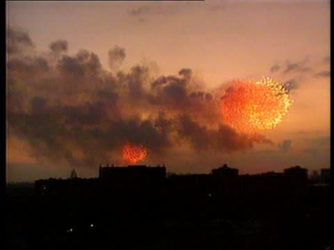 gorbachev returns ussr moscow red square dusk gv skyline as fireworks seen over kremlin gv kremlin as fireworks explode above lms withdrawing tank... - ehemalige sowjetunion stock-videos und b-roll-filmmaterial