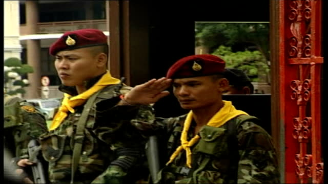 ousted prime minister thaksin shinawatra visits london / thai military leader promises elections for new leader; thai soldier saluting official car... - coup d'état stock videos & royalty-free footage