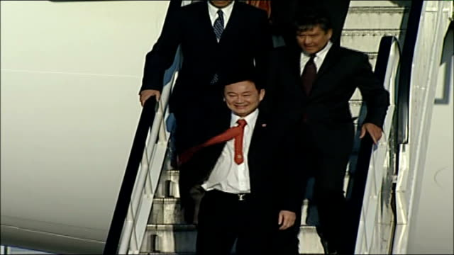 ousted prime minister thaksin shinawatra visits london / thai military leader promises elections for new leader; england: sussex: crawley: gatwick... - coup d'état stock videos & royalty-free footage