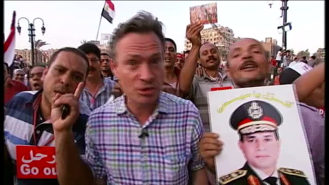 military coup underway; egypt: cairo: tahrir square: ext anti-government protesters dancing and clapping group of protesters clapping protester... - coup d'état stock videos & royalty-free footage