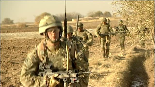 stockvideo's en b-roll-footage met military covenant to be enshrined in law; afghanistan : british soldiers patrolling across desert terrain british soldiers engaged in battle - british military