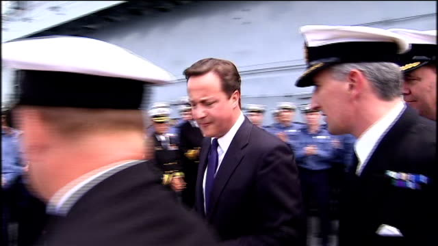military covenant to be enshrined in law; lib canada: nova scotia: halifax: various of david cameron mp meeting officers and ratings on board hms ark... - 証書点の映像素材/bロール