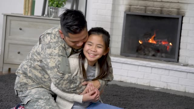 Military Dad Hugging His Young Daughter